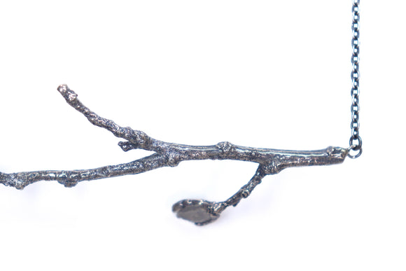 silver twig necklace with a diamond slice leaf