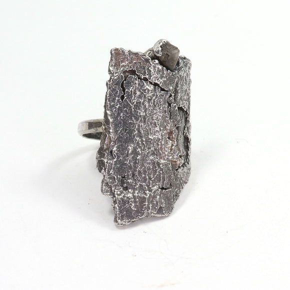 silver tree bark ring with raw cast in place diamond