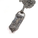 silver tree bark necklace with raw cast in place diamond