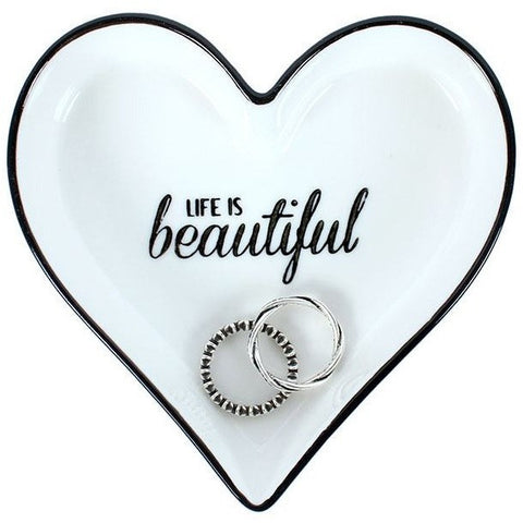 'Life Is Beautiful' jewelry dish is in the shape of a heart and has a black and while color scheme with the message in black script.