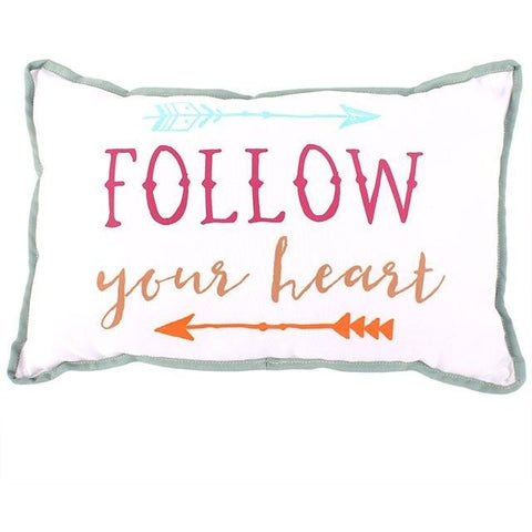 "Decorative pillow features an arrow design and the message ""Follow Your Heart"" printed on one side. Pillow has a white background, colorful graphics and green trim."