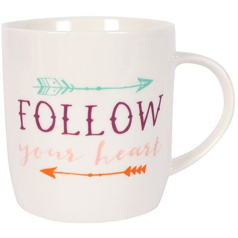Mug has a white background and 2 boho style arrows, one in mint green and one in bright orange. Message is in purple and pink text.