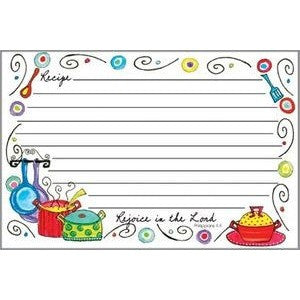 Recipe cards have colorfully designed cookware at the bottom and scrolled decorations around the sides.