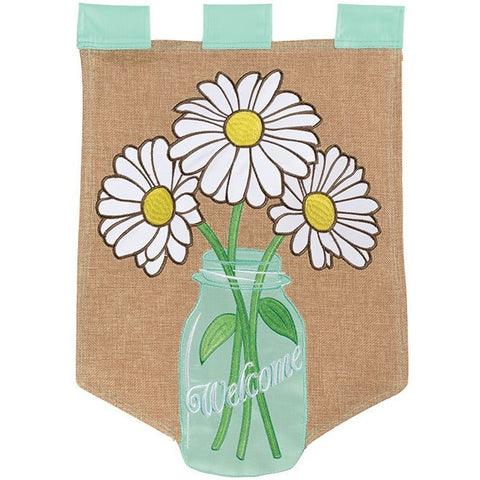 Flag has a burlap background and hangs off 3 mint green straps. Design is mint green mason jar with 3 white and yellow daisies and the message 'Welcome'.