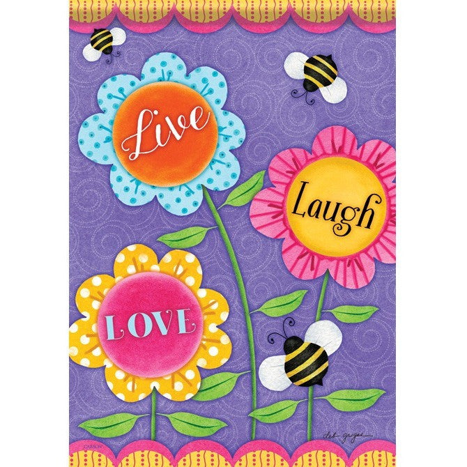3 brightly colored flowers have the message to 'Live Laugh Love'. 3 large bees fly around the flowers.