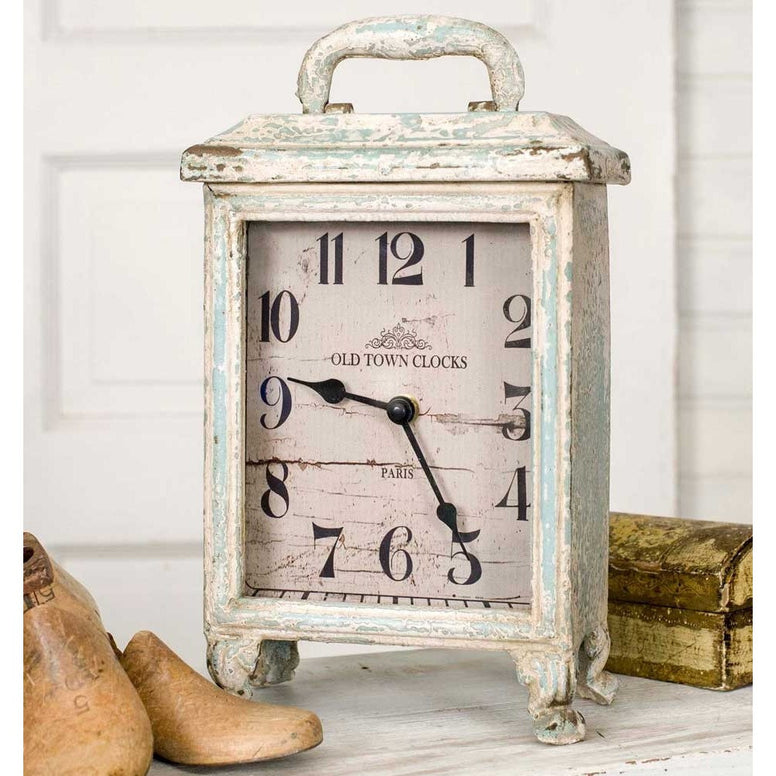 Shabby chic style tabletop carriage clock has a distressed finish and vintage look.