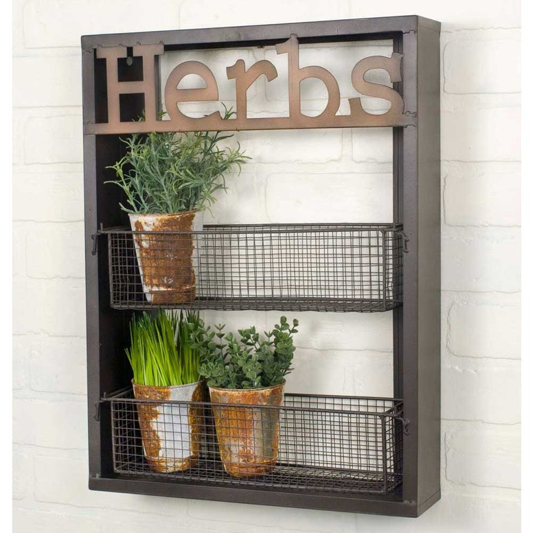 Brown wood and wall shelf has two rectangular shaped metal wire mesh shelves. The label 'Herbs' is cut out of metal and place at the top of shelf.