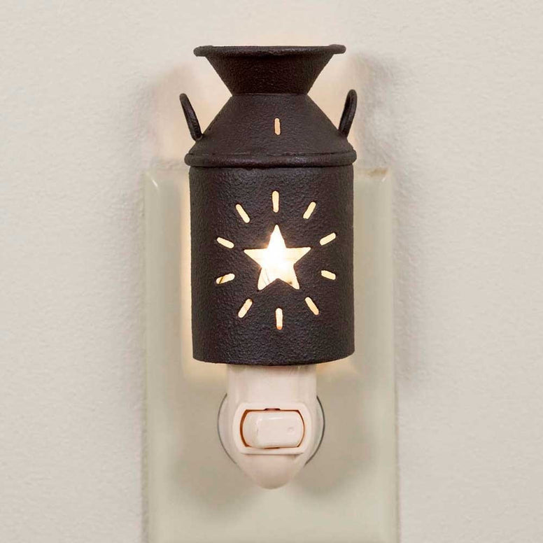 Rustic country style brown metal milk pitcher night light comes with a fun barn star design punched out to let the light shine.