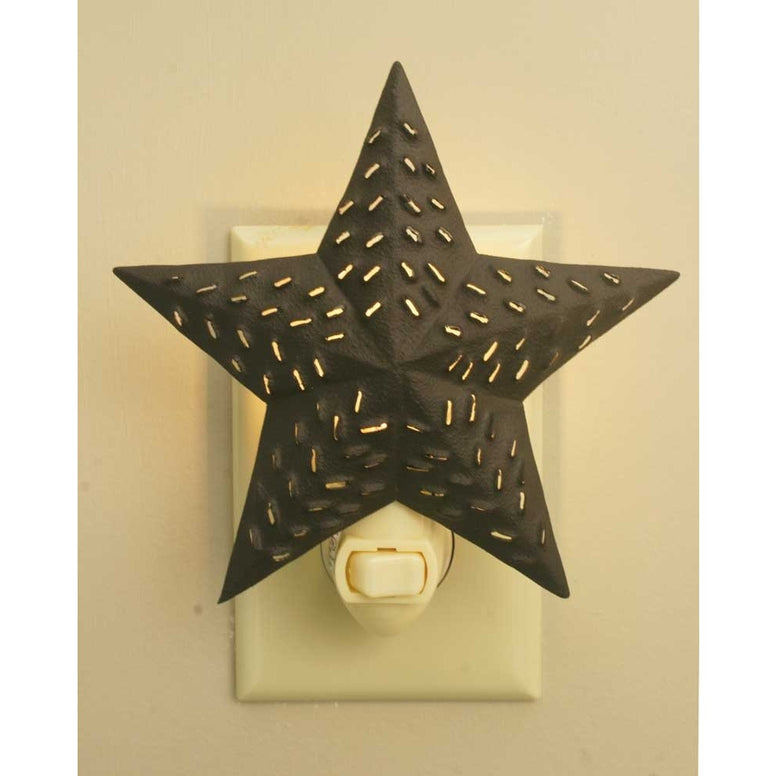 Rustic brown colored metal night light with a star barn design and  a punched pattern that lets the light shine through.