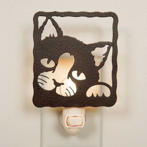 Nightlight is made out of rustic brown metal and features the face of a cat peeking out at the viewer from a square frame.