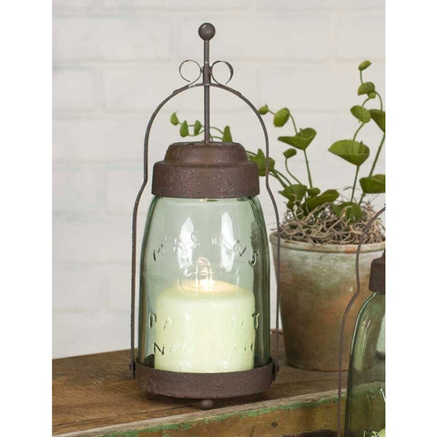 The rusted metal finish and stylized design of this butler lantern brings the perfect vintage look to your decor.