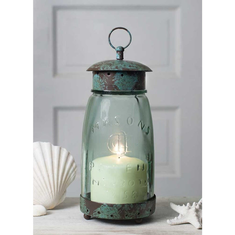 Vintage style lantern has a rustic metal top and bottom and includes a quart sized old fashion style mason jar chimney.