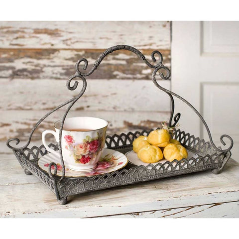 Victorian styled tray features a rustic metal finish, with an ornately scrolled handle and filigree edged tray.