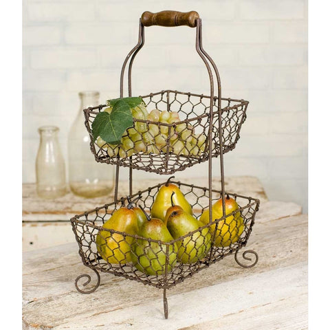 Metal caddy features a rustic finish and a two wire handle topped by a wooden holder. Two chicken wire baskets in graduating sizes give you plenty of space to hold essentials in any room of your house.