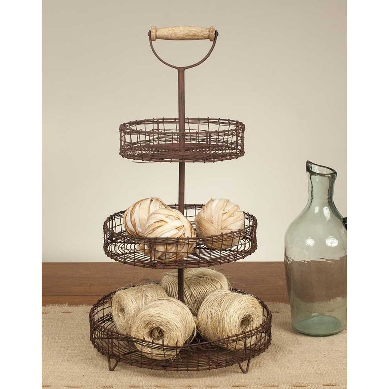 Tall caddy features a rusted finish, 3 round wire metal shelves and a handle for easy carrying.