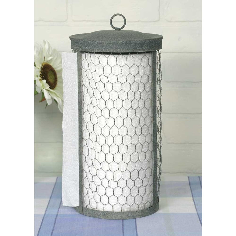 Country styled paper towel holder is made from galvanized metal and features chicken wire mesh and a loop at the top. The distressed finish gives it a vintage style that will look great in any decor.