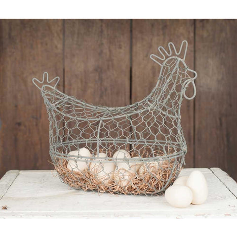 This fun egg holder has a wire base shaped like a chicken and is covered with rustic chicken wire for a farmhouse flair. Enclosed basket opens with a front clip.