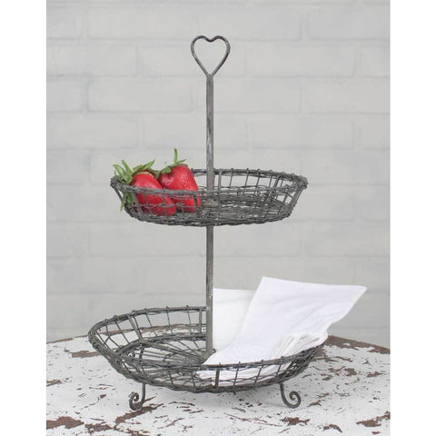 Featuring a farmhouse style galvanized wire design, this unique serving tray has a distressed finish and includes a wire heart at the top.