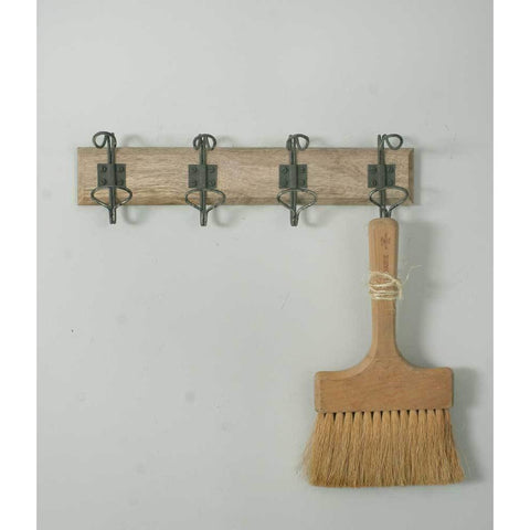 Hanger has a wood back and four metal double hooks that feature a distressed finish.