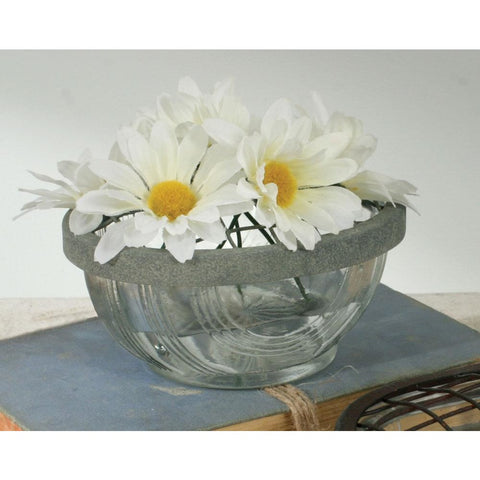 The salt cellar is made of glass and features a swirl design and the metal frog lid has a galvanized finish.