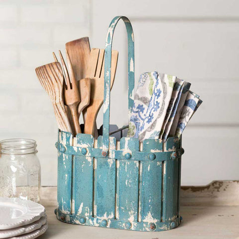 This metal basket features a unique vintage style and blue distressed finish. The tall handle is fixed and a wire partition divides the basket.