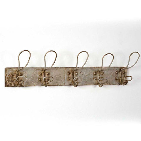 Featuring 5 sturdy double hooks, you'll love the rustic industrial look of this coat rack. This coat rack is made from metal and features a rusted ivory distressed finish.