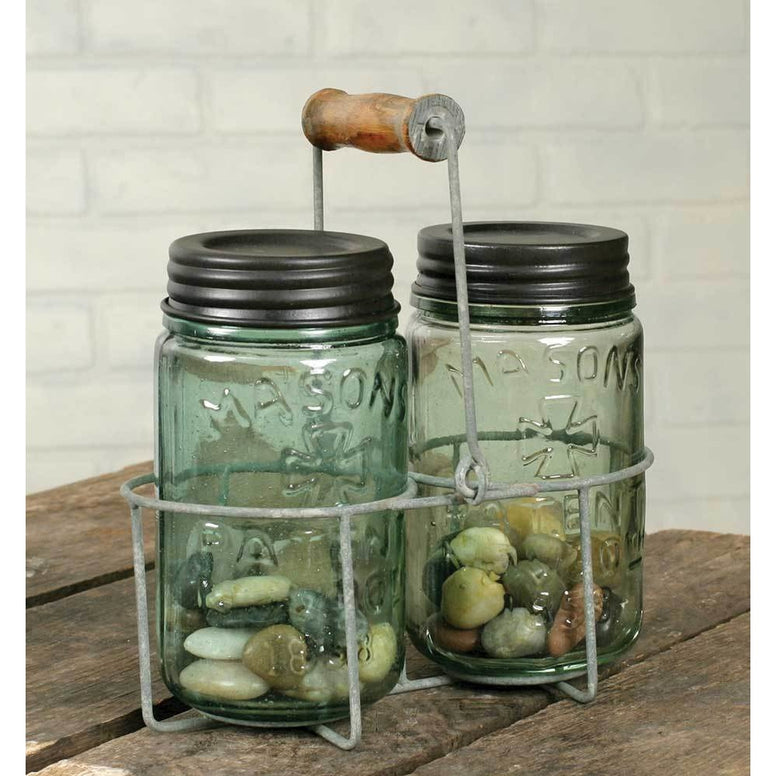 This mason jar caddy that features a distressed barn roof galvanized finish and wooden handle.