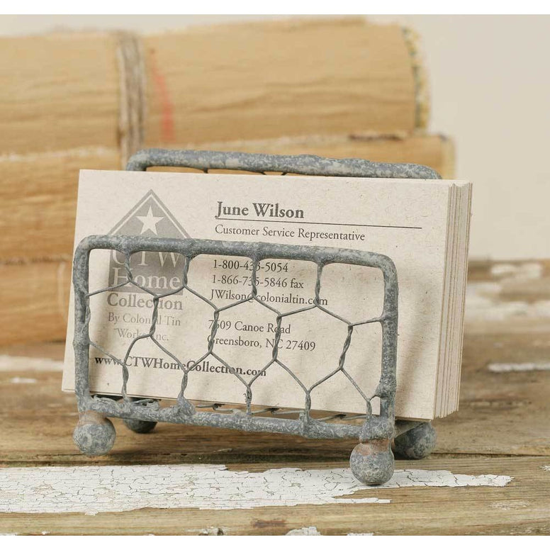 Made from metal and chicken wire, this business card holder features a distressed gray finish