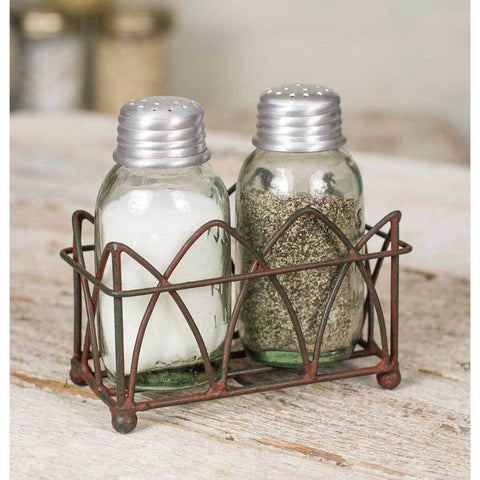 distressed metal caddy that holds two glass Mason jar styled salt and pepper shakers that are included.