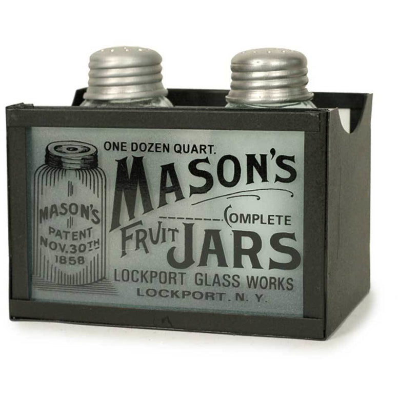 Made from rustic brown metal, the caddy features frosted glass inserts on the front and back. Glass on the front and back that reads: One Dozen Quart Masons Complete Fruit Jars. Lockport Glass Works; Lockport; NY. The salt and pepper shakers are made from glass and have vintage metal style tops.