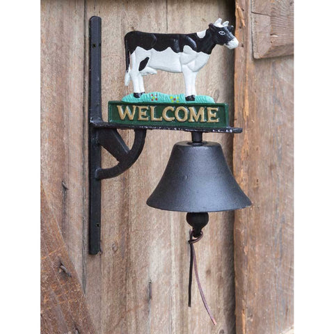 "Hanging bell is made out of black cast metal and features a colorful black and white cow standing on top of a 'Welcome"" Sign"