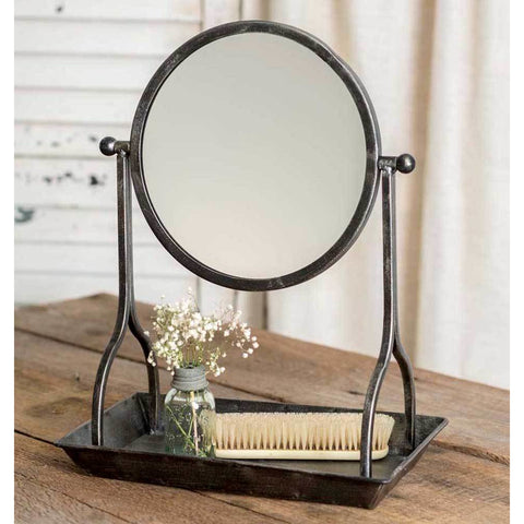 This metal vanity tray features an industrial styled distressed finish and comes with a round mirror.
