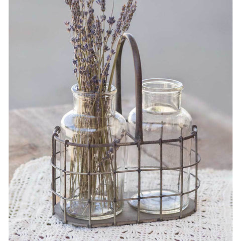 Vintage Farmhouse Style Metal Caddy Featuring Handle and Two Glass Bottles