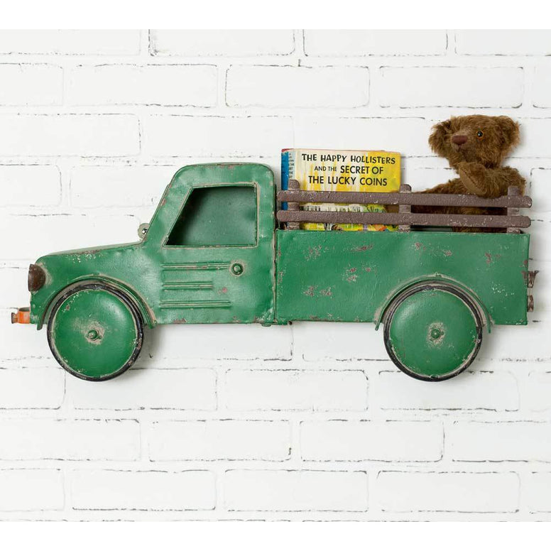 Green metal truck shaped wall hanging has the truck bed as the basket.