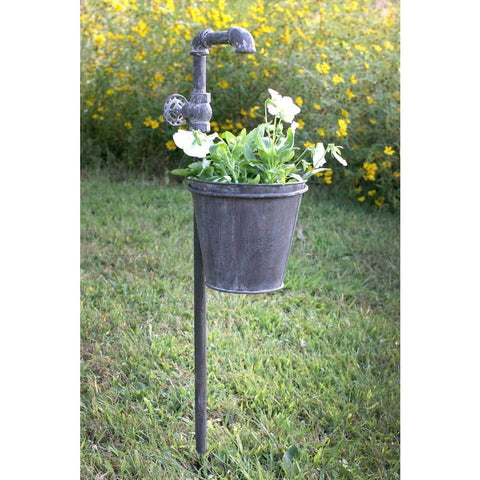 This vintage style garden stake planter features a distressed finish and garden spigot design that looks like water is flowing into the pot.