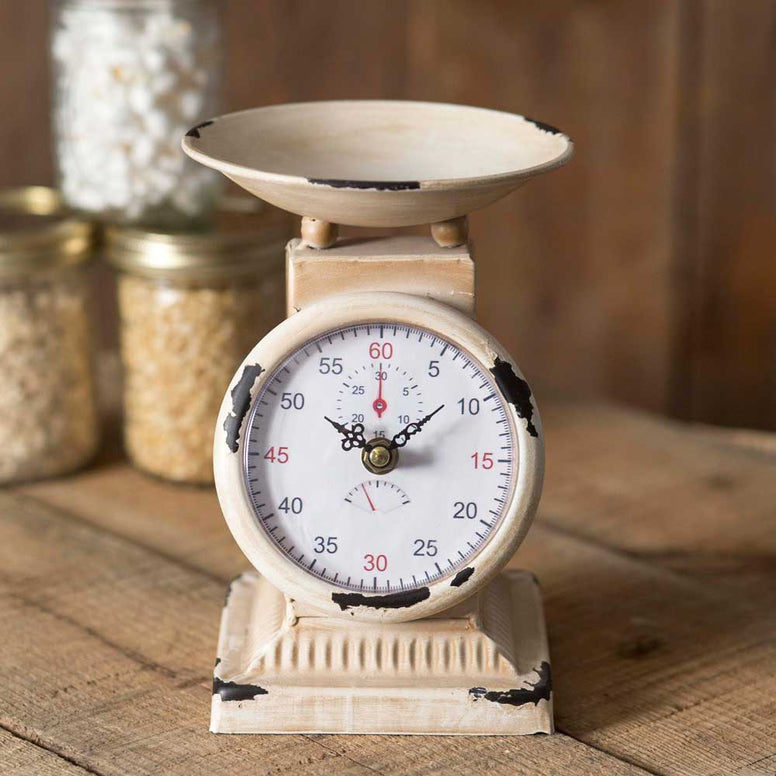 This vintage look clock features the look of an old-fashioned wieght scale and a distressed finish.