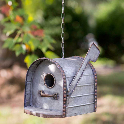 This unique metal birdhouse features a birdhouse design and distressed finish.