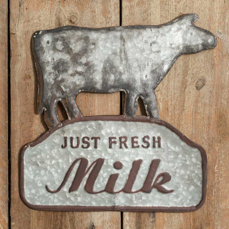 This unique metal wall sign has a fun 'Just Fresh Milk' design that includes a cow on top.