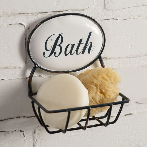 Featuring a black distressed metal design, this soap holder comes with a white oval sign with the word 'Bath' in black script.
