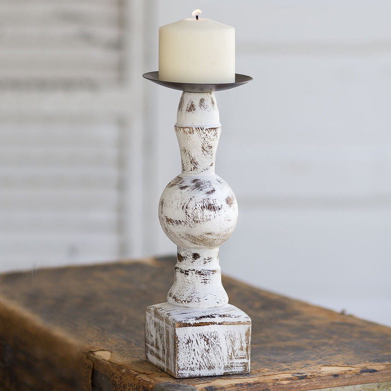 Vintage style wood pillar candle holder that features a white distressed finish and square base.