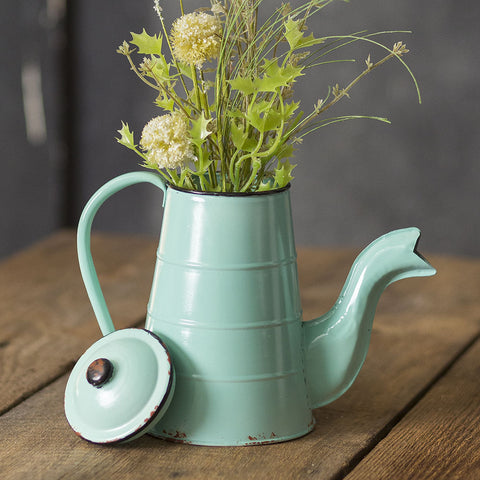 This inspired metal canister is shaped like a vintage coffee pot and features a blue distressed finish. Comes with a lid, handle and uniquely shaped spout.