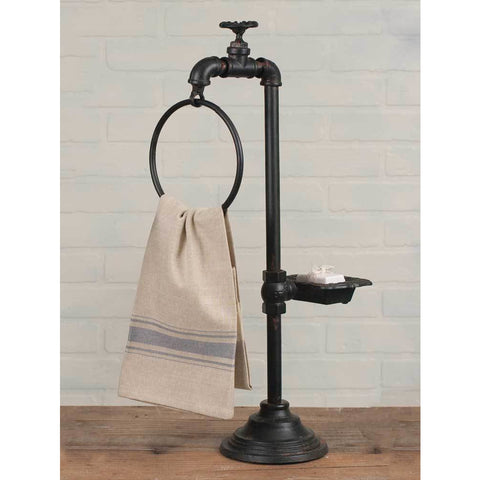 Water Spigot Soap and Towel Holder is made of distressed finish metal and features an industrial look.
