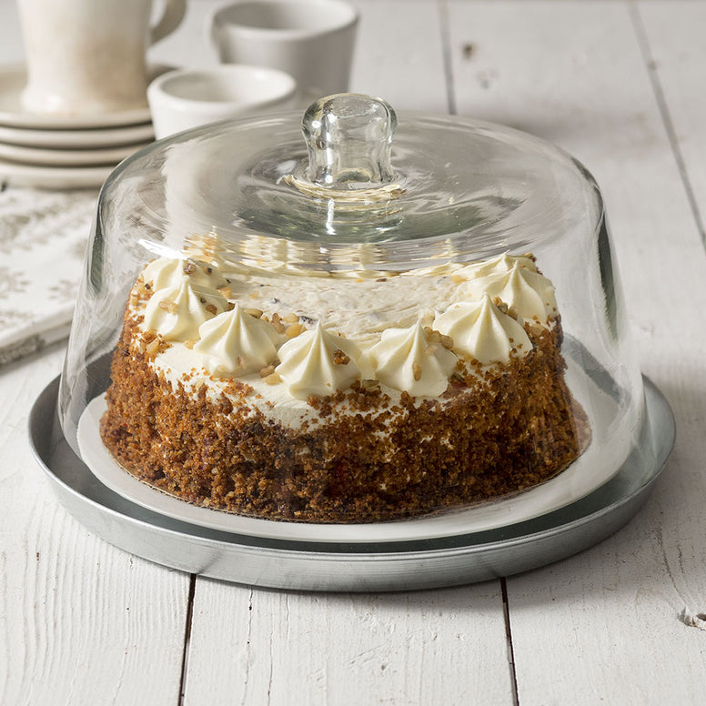 Vintage styled dessert cloche features a clear glass top and gray metal base.