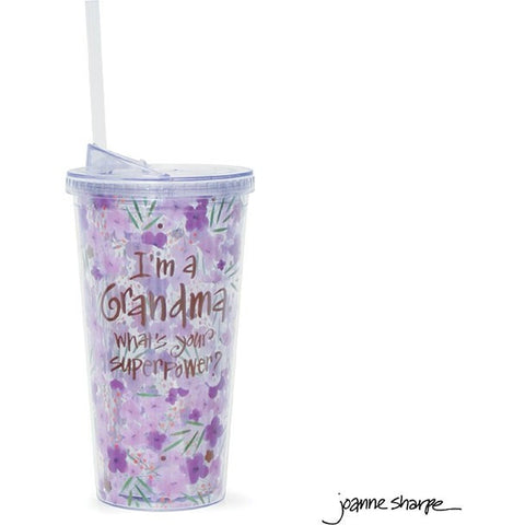 Tall travel cup has a bright purple and pink floral design with the message in gold lettering.