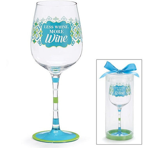 Hand painted wine glass has a brightly hand painted stylized blue and green design and the message 'Less Whine, More Wine' in white. Green and blue stripes decorate the stem and base.