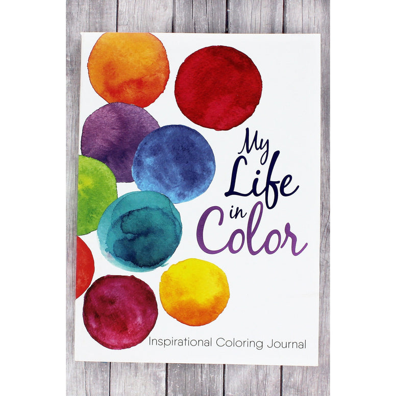 Inspirational coloring journal has a textured white soft cover with bold circles of color. Book title is embossed in metallic purple.