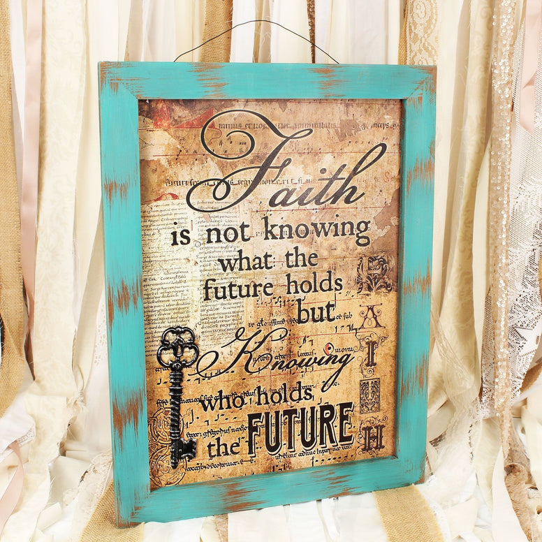 Antiqued teal colored frame surrounds a vintage wall sign with the stylized message in black. Includes the superimposed word 'Faith' on the lower right side and a 3D metal key on the lower left.