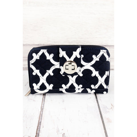 This beautiful wallet is great on it's own, or perfect to carry everything you need in your purse. This piece has quilted construction, a zipped outer pocket and zip around closure of the main section.