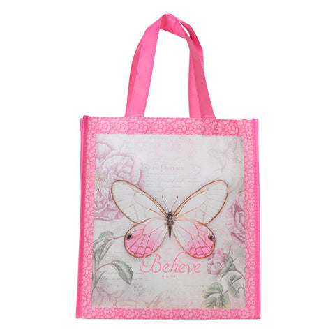Pink 'Believe' tote bag has a sweet old-fashioned floral and butterfly design and features scripture from Mark 9:23. One side of the tote shows a large delicate butterfly and the word 'Believe'. The other side of the tote has a smaller butterfly design and the words 'Everything Is Possible For One Who Believes.'
