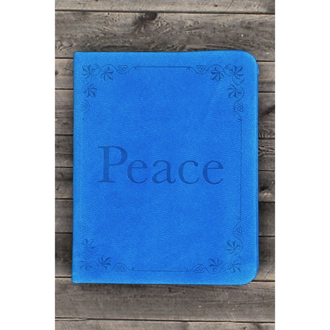 "The book cover is a beautiful blue soft faux leather with a debossed ""Peace"" and floral design on the cover. This lovely book also has silver gilt-edged pages, a ribbon page marker and a front page for gift-giving."